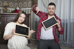 Happy young parents expecting the birth of their unborn child. Royalty Free Stock Images
