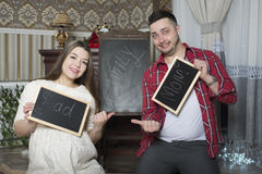 Happy young parents expecting the birth of their unborn child. Stock Photo