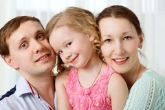 Happy young parents and little daughter royalty free stock photo