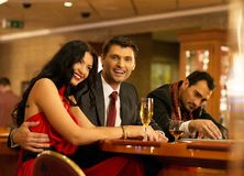 Happy young people behind gambling table Royalty Free Stock Photo