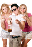 Happy young people with a bottle of whiskey Royalty Free Stock Image