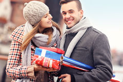 Happy young people with Christmas presents Royalty Free Stock Photography