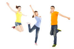 Happy young people dancing and jumping. Over white background Royalty Free Stock Image