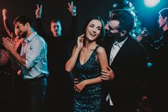 Happy Young People Dancing on New Year Party. Happy New Year. People Have Fun. Indoor Party. Celebrating of New Year. Young Woman in Dress. Young Man in Suit stock photography