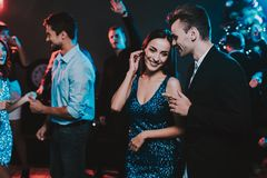 Happy Young People Dancing on New Year Party. Happy New Year. People Have Fun. Indoor Party. Celebrating of New Year. Young Woman in Dress. Young Man in Suit stock image
