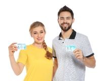 Happy young people with driving licenses on white. Background stock photography