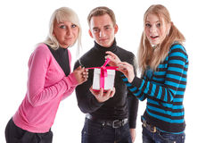 Happy young people with gift box Royalty Free Stock Image