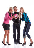 Happy young people with gift box Stock Images