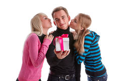 Happy young people with gift box Royalty Free Stock Photos
