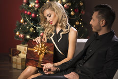 Happy young people give each other gifts Stock Images
