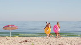 Happy young people go on the beach. stock footage