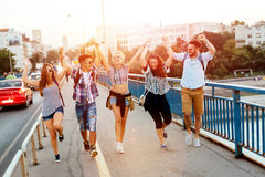Happy young people hanging out. And going to a festival together Royalty Free Stock Photo