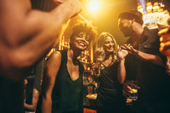 Happy young people having fun a nightclub Royalty Free Stock Photography