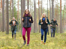 Happy young people hiking in a swamp Stock Image