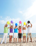 Happy young people holding balloons Royalty Free Stock Image