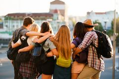 Happy young people hugging looking at city view royalty free stock image