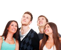 Happy young people looking up Stock Photos
