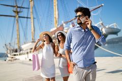 Happy young friends on luxury vacation. Travel, shopping, fun, friends concept. Happy young people on luxury vacation. Travel shopping fun summer friends concept royalty free stock image