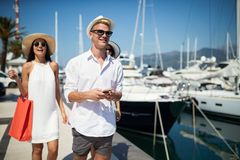 Happy young friends on luxury vacation. Travel, shopping, fun, friends concept. Happy young people on luxury vacation. Travel shopping fun summer friends concept royalty free stock photos