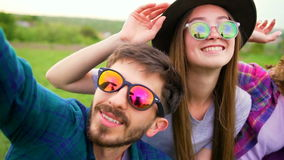 Happy young people making selfie in the field. Two women and two men at summer lifestyle stock video