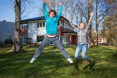 Happy young people with a new house. Young people in love beeing happy because of the new house Stock Photography