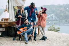 Happy young people at picnic Royalty Free Stock Photos