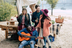 Happy young people at picnic Stock Image
