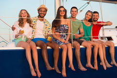 Happy young people sailing on the yacht. Stock Photo