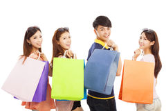 Happy young people with shopping bags Stock Images