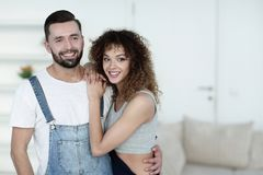 Happy young people standing in a new house Stock Image