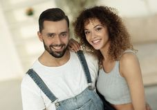 Happy young people standing in a new house Royalty Free Stock Photos