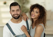 Happy young people standing in a new house royalty free stock photography
