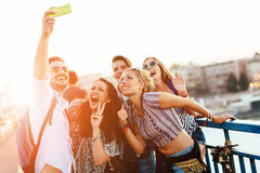 Happy young people taking selfies Stock Photos