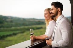 People tasting wine in vineyard Stock Photography