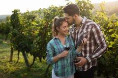 People tasting wine in vineyard Royalty Free Stock Photos