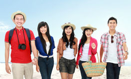 Happy young people on vacation Stock Images