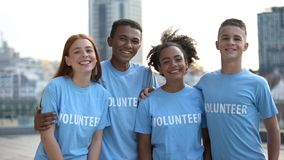 Happy young people volunteer t-shirts posing camera, social teamwork, help