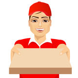 Happy young pizza delivery guy Royalty Free Stock Images