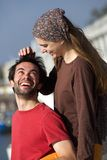 Happy young playful couple smiling together outdoors Stock Photo
