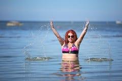 Happy young plus size woman in bikini on sea Royalty Free Stock Photo