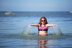 Happy young plus size woman in bikini on sea Royalty Free Stock Image