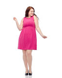 Happy young plus size woman dancing in pink dress Stock Images