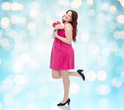 Happy young plus size woman with flower bunch Royalty Free Stock Image