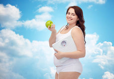 Happy young plus size woman holding scales Royalty Free Stock Photos