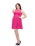 Happy young plus size woman showing thumbs up Stock Images