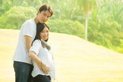 Happy young pregnant Asian couple Royalty Free Stock Images