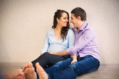 Happy young pregnant couple Stock Photos
