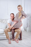 Happy young pregnant couple embrace each other on Royalty Free Stock Photography
