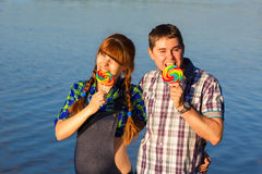Happy and young pregnant couple having fun on the beach. Summer Stock Photography