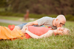Happy and young pregnant couple hugging Stock Photo